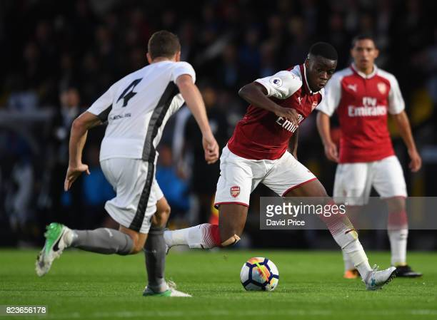 Stephy Mavididi of Arsenal takes on Mark Ricketts of Boreham Wood during the match between Boreham Wood and Arsenal XI at Meadow Park on July 27 2017...