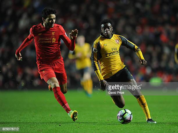 Stephy Mavididi of Arsenal takes on Tiago Ilori of Liverpool during the Premier League match between Arsenal and Stoke City at Anfield on December 12...
