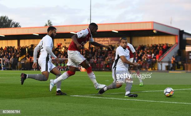 Stephy Mavididi scores his 2nd goal Arsenal's 4th past Dave Stephens of Boreham Wood during the match between Boreham Wood and Arsenal XI at Meadow...