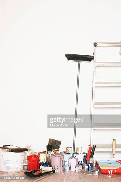 stepladder and decorating equipment against wall - farbeimer stock-fotos und bilder