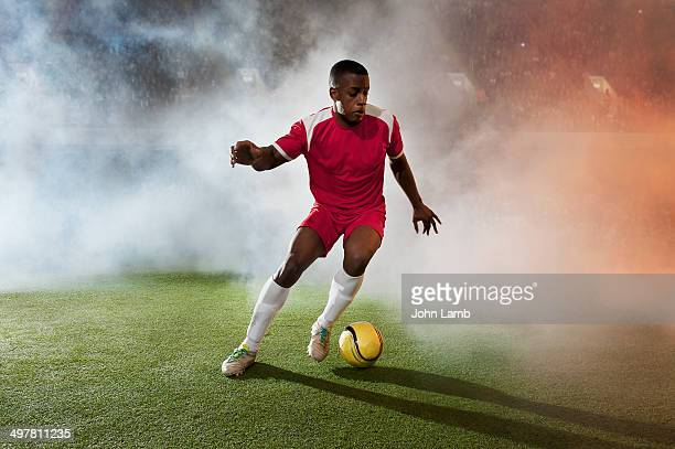 stepover - football player stock pictures, royalty-free photos & images