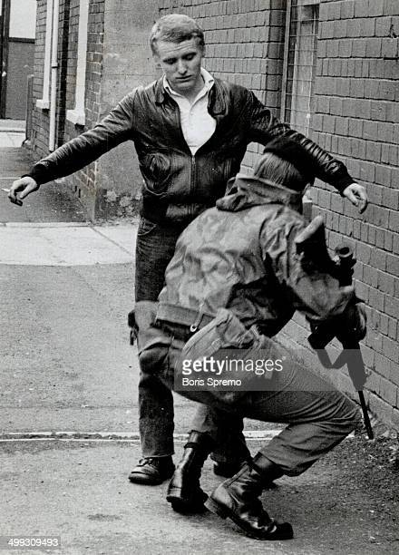 Stepped up security A british soldier last night stops Belfast resident Martin Finnegan 22 on the Kashmir Road and Searches him for weapons Armed...