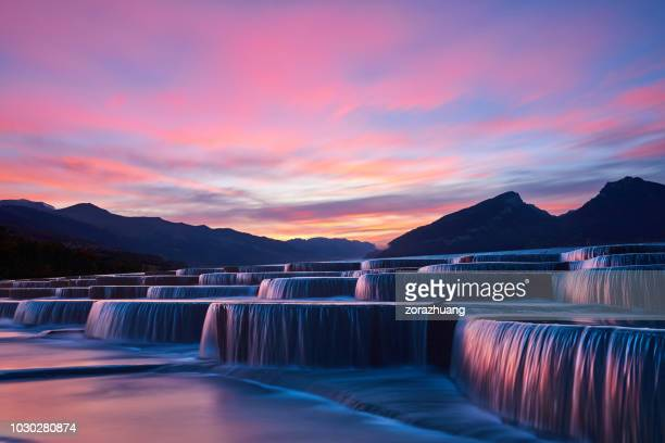 stepped waterfall group at sunrise - sunset lake stock photos and pictures