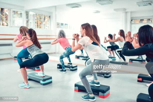 stepper squats by female athletes in gym - beautiful female bottoms stock pictures, royalty-free photos & images
