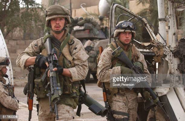 Stepping back into the battlefield US Marines of the Light Armored Reconnaissance company of 1st Battalion 3rd Marines clear houses at the site where...