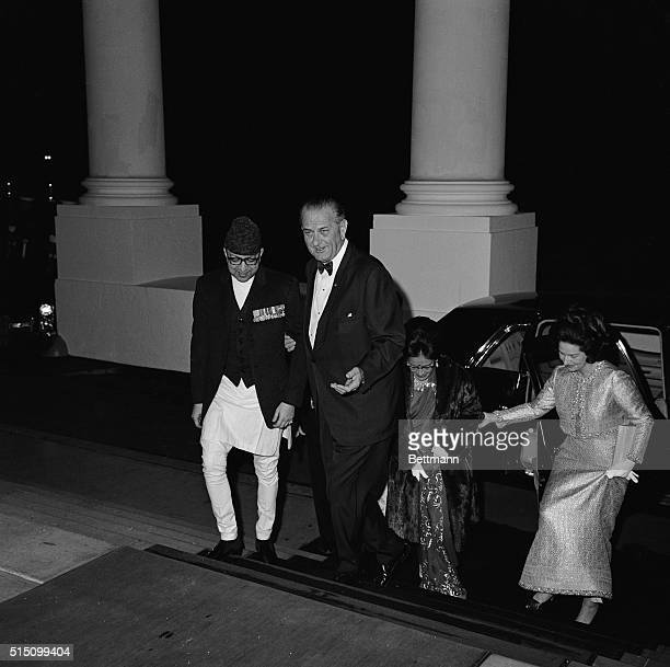 Stepping into the White House Washington DC President Johnson and Ladybird lend a hand as they escort King Mahendra and Queen Rafna up the steps to...