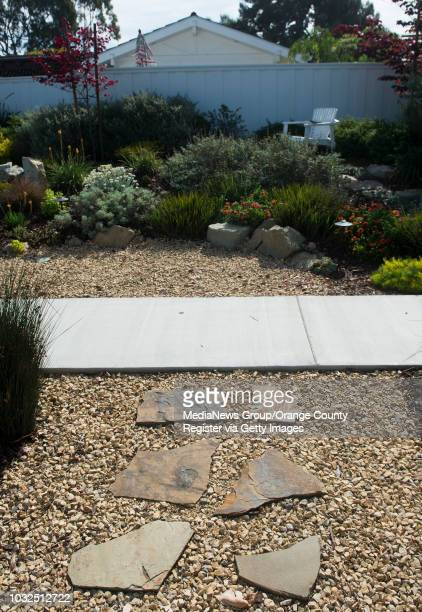 Stepping stones and a gravel covered drainage ditch as just a few of the elements in Mia Alexis' droughtresistant Californiafriendly Newport Beach...