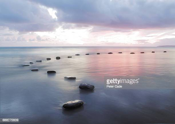 stepping stones in water - thoroughfare stock pictures, royalty-free photos & images