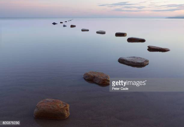 stepping stones in water - idyllic stock pictures, royalty-free photos & images