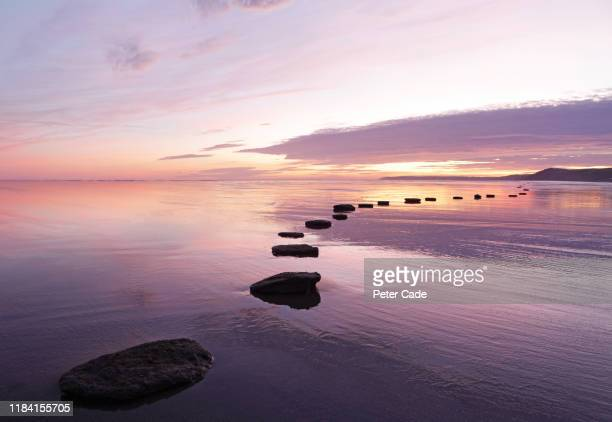 stepping stones over tranquil water - sky stock pictures, royalty-free photos & images