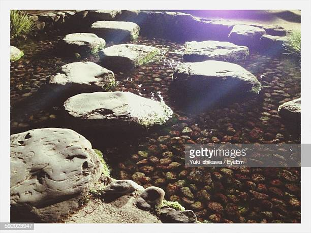 Stepping Stones Over Water In Pond