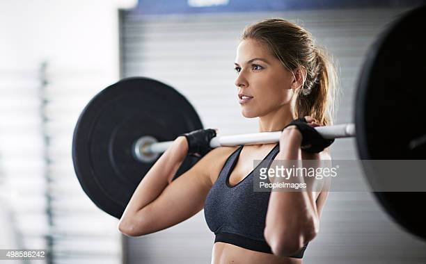 stepping up her workout routine - barbell stock pictures, royalty-free photos & images