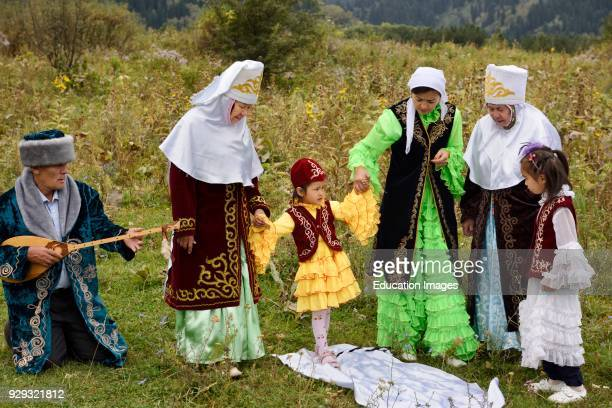 Steps after Tusau Kesu cutting the rope Kazakh traditional family ceremony blessing of young child