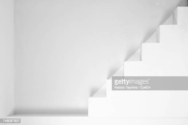 Steps Against White Wall In Modern Building