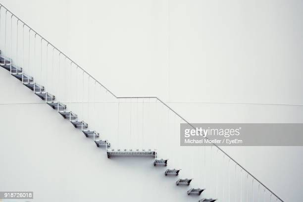 steps against white wall - steps stock photos and pictures