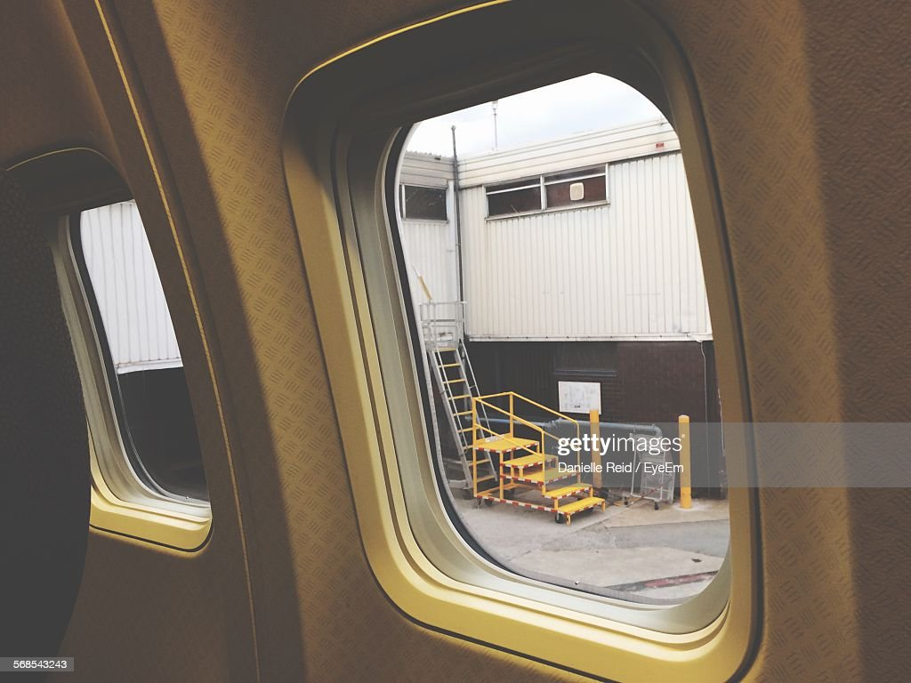 Steps By Building Seen Through Airplane Window : Stock Photo