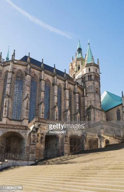 steps by erfurt cathedral against blue sky during sunny day, germany - erfurt stock-fotos und bilder
