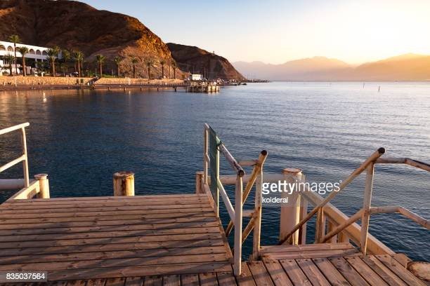 steps descent to the beach of the red sea - eilat stock pictures, royalty-free photos & images