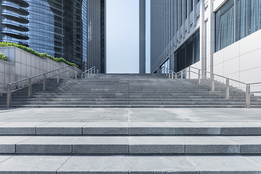 steps front of modern building in city of China. - gettyimageskorea