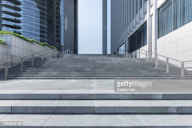 steps front of modern building in city of china. - stufen stock-fotos und bilder