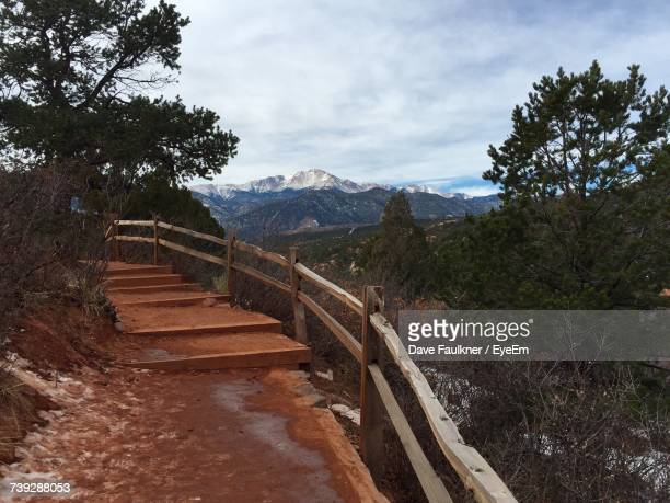 Steps Leading Towards Mountains Against Sky