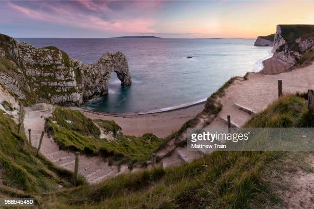 Steps on a winding path overlooking the Jurassic Coast, Dorset, England, UK.