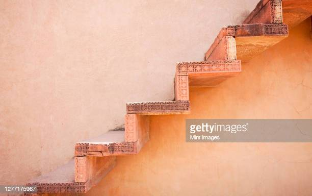steps on an exterior wall - fatehpur sikri stock pictures, royalty-free photos & images