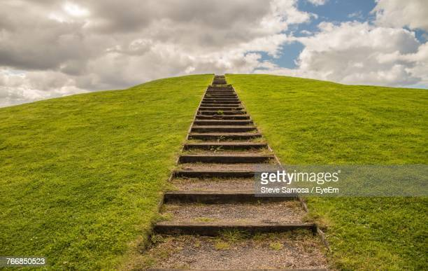 Steps On Field Against Sky