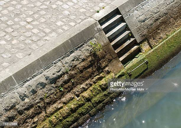 steps on quay leading to river, high angle view - quayside stock pictures, royalty-free photos & images