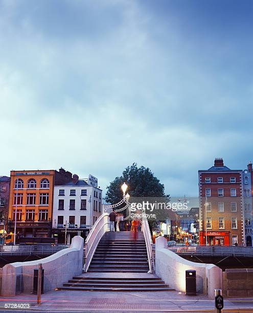 steps on the ha'penny bridge in dublin, ireland - penny for the guy stock photos and pictures