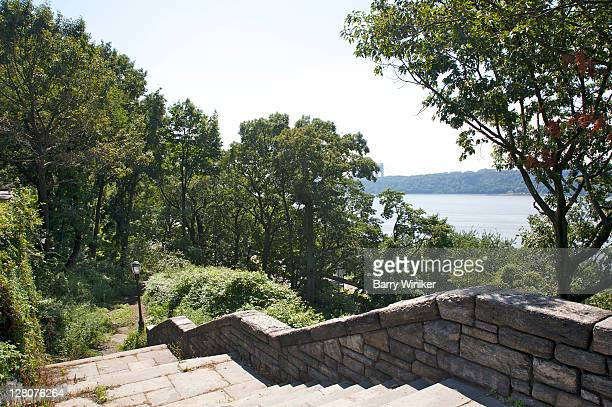 steps, trees and view of hudson river from fort tryon park, new york, ny - wpa stock pictures, royalty-free photos & images