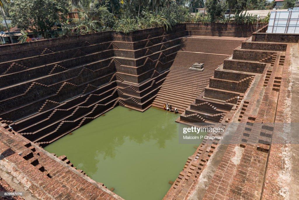 Stepwell and temple pond at Sri Subrahmanya (Subramaniya) Temple, Peralassery, Kannur : Stock Photo