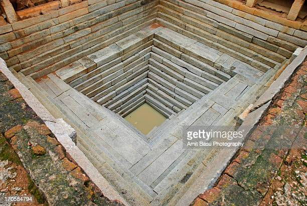 stepwell at a temple, karnataka, india - stepwell stock photos and pictures