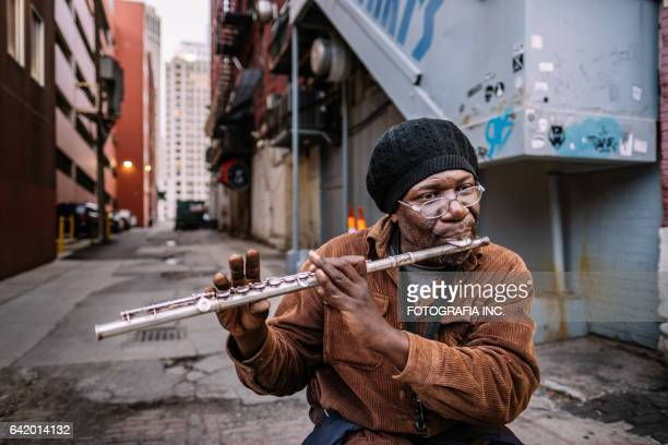 stereet performer in detroit - black alley stock photos and pictures