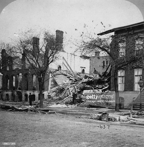 Stereograph of view of the southern limits of the Great Chicago Fire located at 330332 Wabash near Congress blown up by General Sheridan to halt the...