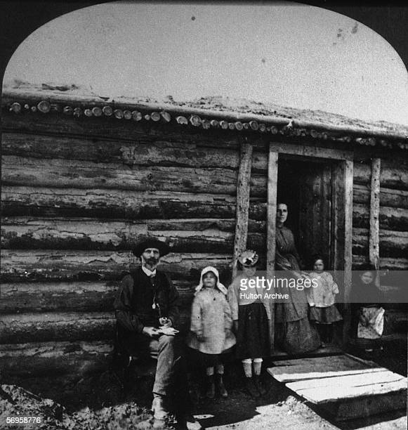 Stereopticon image of a family outside their habitat on their ranch Western US late 19th Century