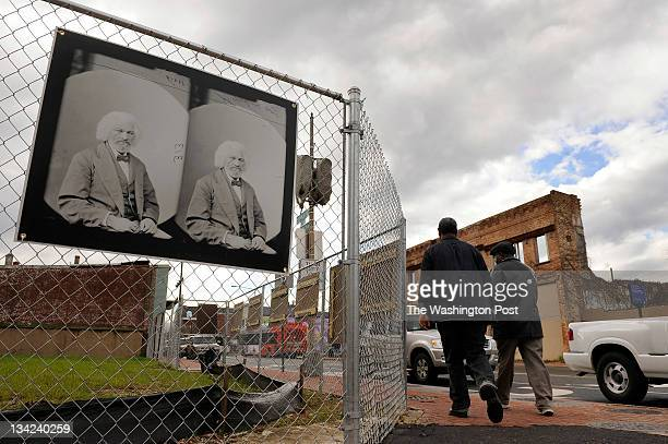 A stereoscope of Frederick Douglass hangs on a fence at the corner of Good Hope Road SE and Martin Luther King Jr Blvd SE on Wednesday November 23...