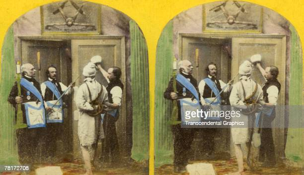 Stereoscopic colorized view of a Masonic rite shows a bound man as he is led to a doorway 'guarded' by two men in complicated livery France mid to...
