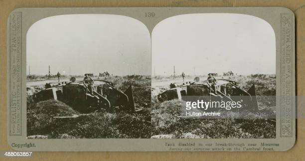 A stereoscopic image of a soldier sitting on a disabled British Mark IV tank after the Battle of Cambrai France World War I circa December 1917 The...