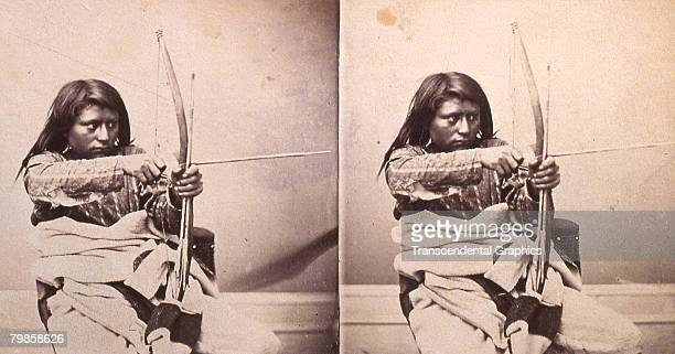 Stereoscopic image of an Ute brave as he draws his bow and arrow Salt Lake City Utah 1900s