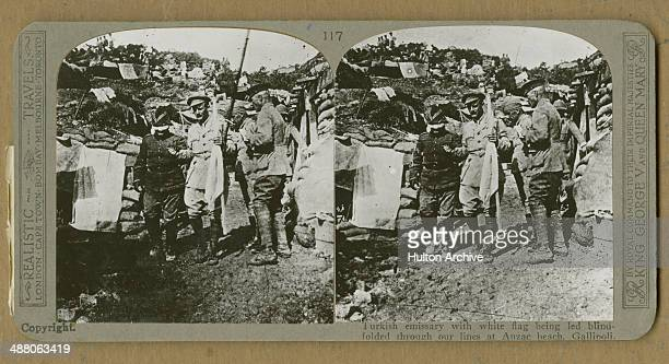 A stereoscopic image of Australian Major Sam Butler of the Australian and New Zealand Army Corps carrying a white flag and leading a blindfolded...