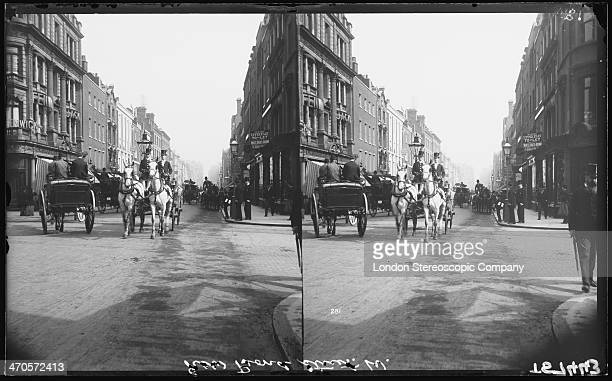 A stereoscopic image of horsedrawn traffic on New Bond Street in Mayfair London circa 1890 In the centre is a carriage driven by uniformed coachmen...