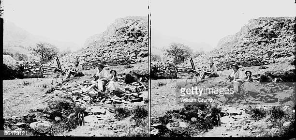 Stereoscopic image of two men and a woman sitting by a moorland stream, circa 1857.