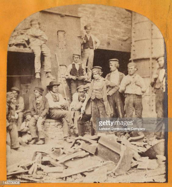 A stereoscopic image of workers gathered around the cupola furnace in the viaduct works during the construction of the Crumlin Viaduct in South Wales...
