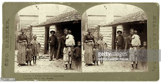 Stereoscopic image shows a portrait of a poor family as they stand near their home St Augustine Florida 1888