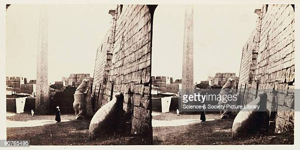 A stereoscopic photograph of the obelisk and heads of a pair of seated statues at the ruins of the Temple of Luxor Egypt taken in 1859 by Francis...