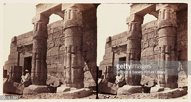 A stereoscopic photograph of the ruined pillars at the entrance to the ruined temple of Errebek at Thebes Egypt taken in 1859 by Francis Frith This...