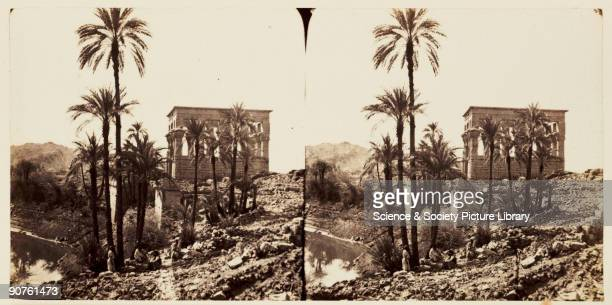A stereoscopic photograph of the small temple of Hathor seen beyond palm trees on the island of Philae Aswan Egypt taken in 1859 by Francis Frith...