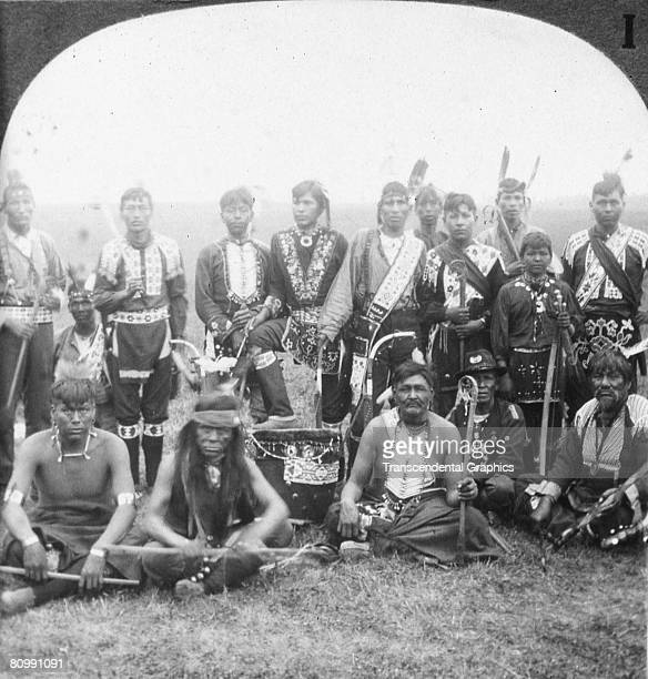 A stereoscopic portrait depicts the Sioux Council New York early 20th century The photograph was published by the Keystone View Company