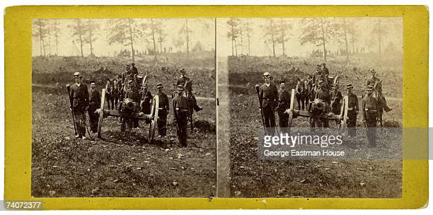 Stereoscopic portrait of a group of unidentified soldiers as they man a cannon on the battlefield near Manassas, Virginia, early 1860s. During the...